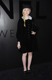 Well, hello there, pilgrim! Elle Fanning gets 10 points for creativity and 10 more for her fearless fashion sense.