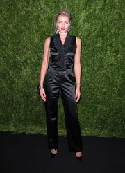 Jessica Hart donned a black satin jumpsuit with a ruched and ruffled bodice for the Chanel dinner in honor of Keira Knightley.