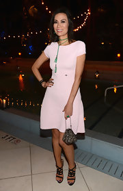 Wendi Deng was seen wearing a basic white A-line dress at a benefit auction hosted by Chanel.