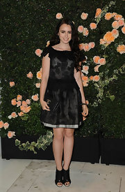 Lily Collins was chic in black at the Chanel fete in LA. She topped off her look with black ankle peep-toe booties.