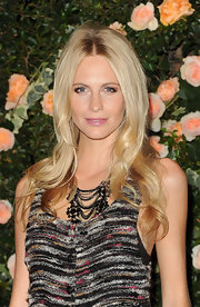 Poppy Delevigne wore her bright blond locks long and luxurious at the Chanel Boutique in Los Angeles.