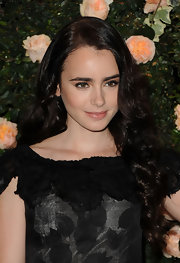 Lily Collins wore just a touch of smoky eyeliner at the Chanel boutique in Los Angeles.