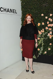 Christina Hendricks opted for a black and burgundy ensemble at the Chanel event in LA. She topped off her look with black peep-toe pumps complete with bow detailing.