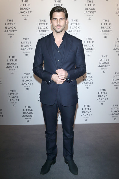 Johannes Huebl chose a classic navy suit with notch lapels for his look at 'The Little Black Jacket' Exhibit opening.