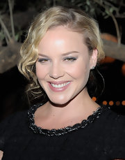 Abbie Cornish wore a casual updo to the 'Chanel: Her Life' celebration. Her look is easy to create and offers a lot of room for imagination. To being, make a side part and section out a three-inch piece of hair along the front hair-line and pull the rest of hair back into a loose ponytail. You could then wrap the ponytail into a bun, or loop one-inch pieces and pin them into place. The options are endless. To finish the look, take a medium-barreled curling iron and make a few waves in the piece that was sections out and mist with a little hairspray.