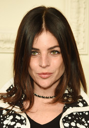 Julia Restoin-Roitfeld wore a sleek center-parted hairstyle during the Chanel Paris-Salzburg show.