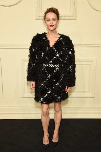 Vanessa Paradis made an ultra-glam appearance at the Chanel Paris-Salzburg show in a chain-embellished black fur coat from the label.