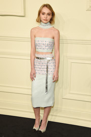 Lily-Rose Depp donned an adorably chic Chanel Couture beaded tube top in pastel blue and pink for the label's Paris-Salzburg show.
