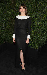 Felicity looked like a glamorous Quaker in this white collared and cuffed black glitzy gown.
