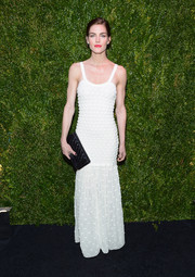 Hilary Rhoda complemented her dress with a classic black quilted clutch by Chanel.