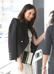 Meghan Markle accessorized with a stylish striped cross-body bag by Oroton at CHOGM London 2018.