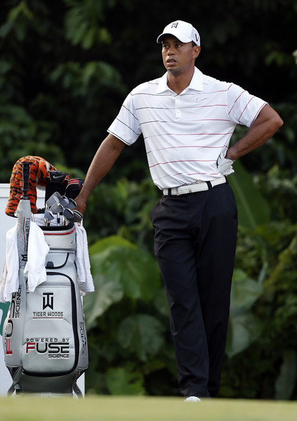 Tiger sported a white striped polo for his on-the-course look.