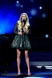 Kelsea Ballerini dazzled in a green lace fit-and-flare dress by Ese Azenabor at the CMA 2016 Country Christmas.