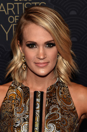 Carrie Underwood showed off flawlessly styled feathered waves at the CMT Artists of the Year event.