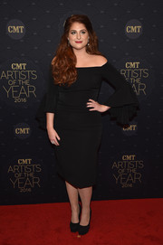 Meghan Trainor cut an elegant picture in a black off-the-shoulder dress with bell sleeves at the CMT Artists of the Year event.