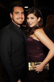 Hillary Scott carried a glimmering gold clutch with a subtle feather print.