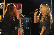 Carrie Underwood wore her hair in bouncy curls with straight wispy bangs during a rehearsal.