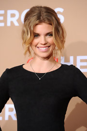 AnnaLynne paired her demur long-sleeve dress with soft ringlet curls. Her center part 'do was elegantly pinned up in a loose bun.