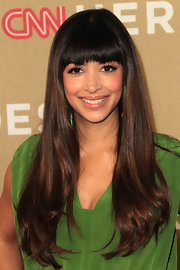 Hannah Simone wore her shiny locks long and straight with lovely brow-grazing bangs at the 2011 CNN Heroes: An All-Star Tribute.