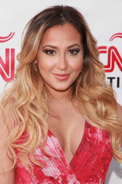 A pink lip gloss gave Adrienne Bailon's pout a luscious look!