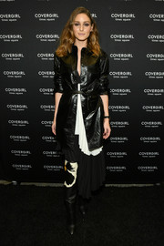 Olivia Palermo was rocker-chic in a black leather coat at the CoverGirl flagship store opening.