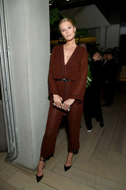 Toni Garrn styled her look with black ankle-tie pumps.