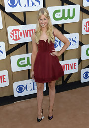 Beth Behrs opted for a playful silhouette with this flared frock, but its ox blood hue added a more mature touch to the look.