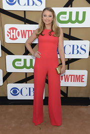 Elisabeth Harnois went for a monochromatic look with this sleeveless coral jumpsuit.