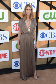 Dawn Olivieri's deep brown draped dress showed off her long and lean frame.