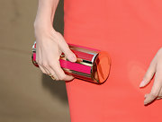 Lizzy's pink and gold cylindrical clutch completed her summer evening look.