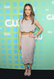 Maggie Q completed her look with a pair of stylish gray platform sandals featuring metallic ankle straps.