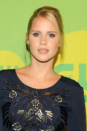 Claire Holt pinned back her lovely blonde tresses for a fun and flirty look at CW's Upfront.