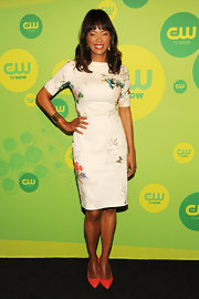 Aisha Tyler's floral and butterfly-print dress gave the actress a fun and playful red carpet look.