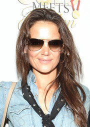 Katie Holmes arrived for the Gold Meets Golden event wearing a pair of aviator sunglasses.