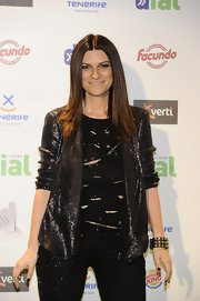 Laura Pausini brought some glam edge to her look with this amazing gunmetal sequined jacket.