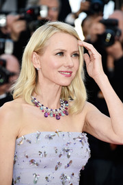 Naomi Watts accessorized with a stunning gemstone statement necklace by Bulgari at the Cannes opening gala.