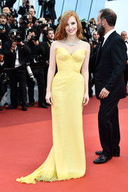 You can always count on Jessica Chastain to bring a lovely pop of color to the red carpet. For her Cannes opening gala look, she chose this gorgeous strapless yellow gown by Armani.
