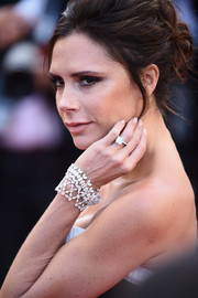 Victoria Beckham looked appropriately posh with her Chopard diamond bracelet at the Cannes opening gala.