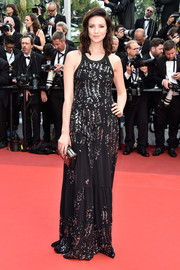 Caitriona Balfe walked the Cannes opening gala red carpet wearing a beaded black gown by Louis Vuitton.