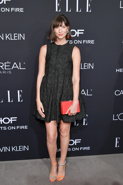 Caitriona Balfe Baby Doll Dress [elle,hearts on fire,loreal paris,red carpet,clothing,dress,cocktail dress,fashion model,little black dress,shoulder,fashion,premiere,footwear,joint,los angeles,beverly hills,california,25th annual women in hollywood celebration,calvin klein,caitriona balfe]