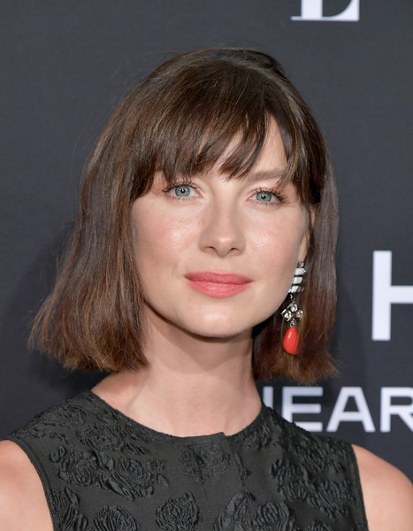 Caitriona Balfe Short Cut With Bangs [elle,hearts on fire,loreal paris,red carpet,hair,face,hairstyle,chin,bangs,eyebrow,blond,layered hair,brown hair,lip,los angeles,beverly hills,california,25th annual women in hollywood celebration,calvin klein,caitriona balfe]