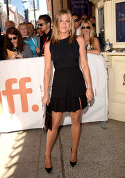 A tiered black Emanuel Ungaro mini added a flirty touch to Jennifer Aniston's look.