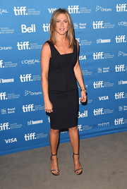 Jennifer Aniston styled her LBD with a pair of chain-embellished sandals by Saint Laurent.