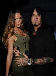 Rock star Nikki Six showed off his colorful sleeve tattoo while attending the Black Ops Launch party.