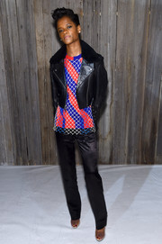 Letitia Wright teamed her top with a pair of black satin pants.