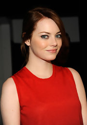 Emma Stone wore her hair in a long sleek ponytail at the Calvin Klein fall 2012 fashion show.