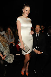 Lara Stone added color to her fitted white frock with orange platform pumps.