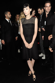 Rooney Mara accessorized her LBD with black strappy sandals.