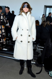 Carine Roitfeld looked super cozy in a double-breasted white teddy bear coat while attending the Calvin Klein fashion show.