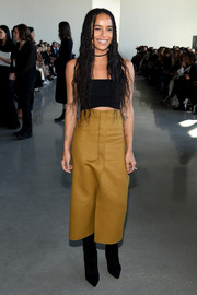 Zoe Kravitz looked cool in a tight black crop-top while attending the Calvin Klein fashion show.